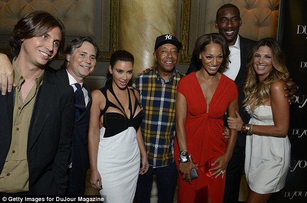 Fashionable friends: Kim was seen with Jonathan, Jason Binn, Kim Kardashian, Russell Simmons, Alexis Welch, Amar'e Stoudemire and Daisy Fuentes