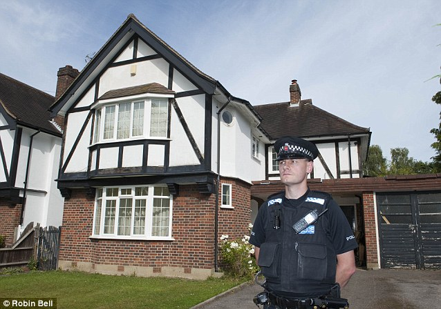 The home of murdered aeronautical engineer Saad Al Hilli, in Claygate, Surrey, was under police guard today