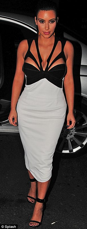 Dressed to impress: Kim opted for a monochrome ensemble for the evening