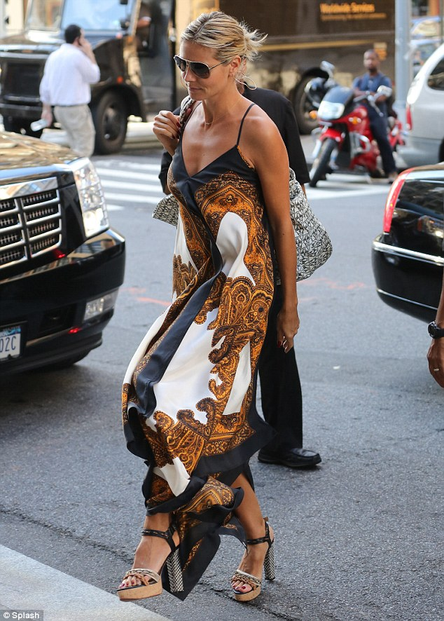 Long and flowing: Earlier today, Heidi stepped out looked stunning in a pretty printed maxi dress, which she teamed with chunky sandals