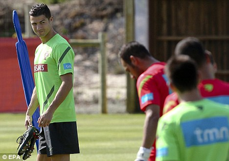 Down in the dumps: Cristiano Ronaldo (left) is unhappy at Real Madrid