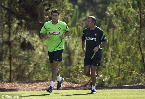 On duty: Ronaldo (left) in training at Praia del Rey with the Portugal squad