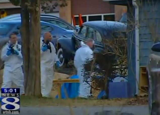 Investigation: Police forensic experts examine the property in Groton, Connecticut