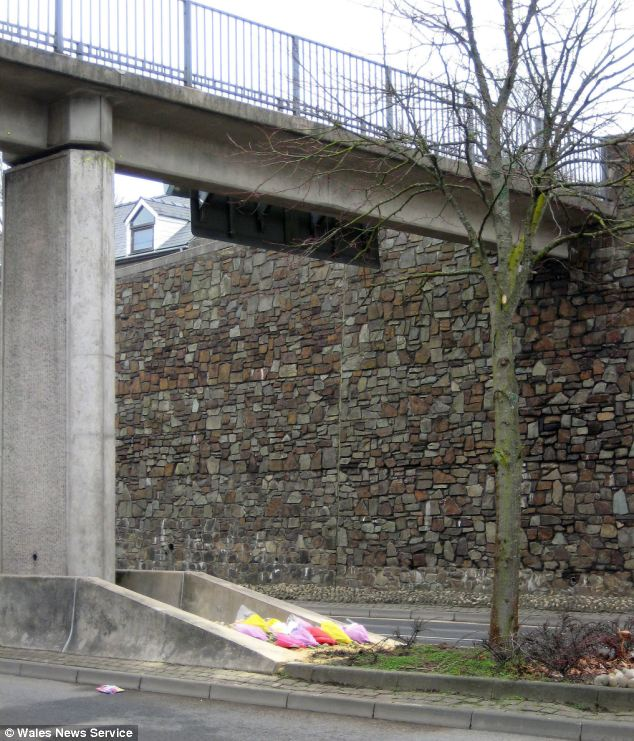 Flowers mark the scene where 19-year-old Joanne Griffiths a heartbroken teenager fell to her death