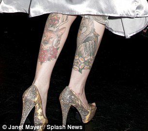 Body art: Darling has a number of tattoos on her arms and legs
