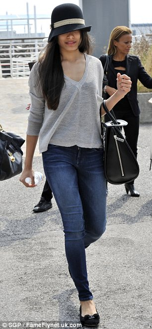 Keeping it under her hat: Frieda Pinto was seen hiding her face as she arrived