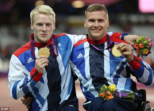 Champs: Weir (right) with Jonnie Peacock