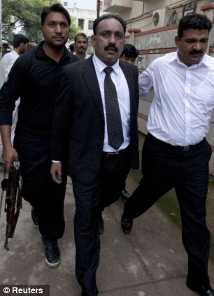 Tahir Naveed Chaudhry leaves with armed security after appearing at her bail hearing