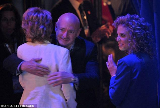 Former congresswoman Gabrielle Giffords receives a hug from husband astronaut Mark Kelly