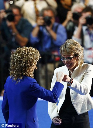 We did it: Former Rep. Gabrielle Giffords (D-AZ) (R) and Rep. Debbie Wasserman Schultz (D-FL) react Giffords had successfully completed the pledge on stage at the DNC in Charlotte, North Carolina