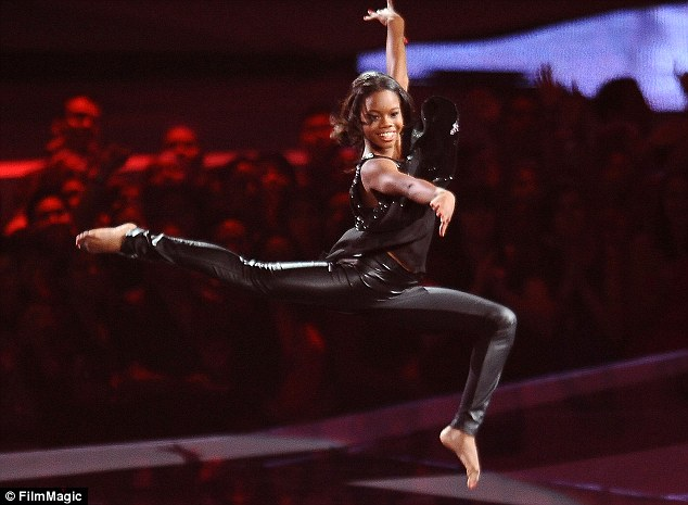 Stunning: Gabby showed off array of flips and leaps as she commanded the attention of the audience