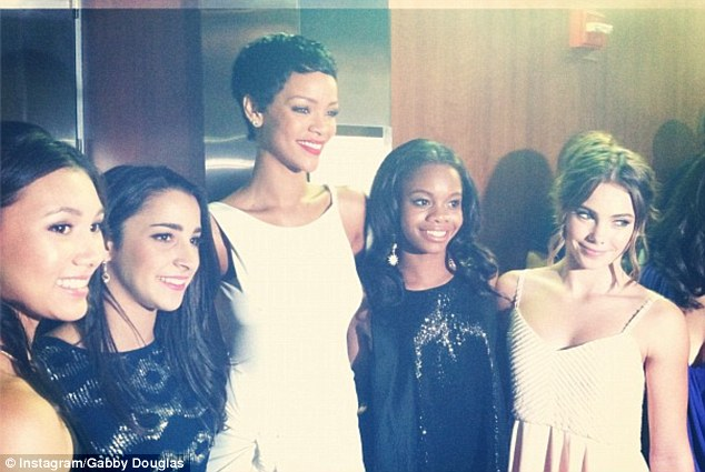 Making new friends: Gabby and members of her gymnastic team posed with Rihanna