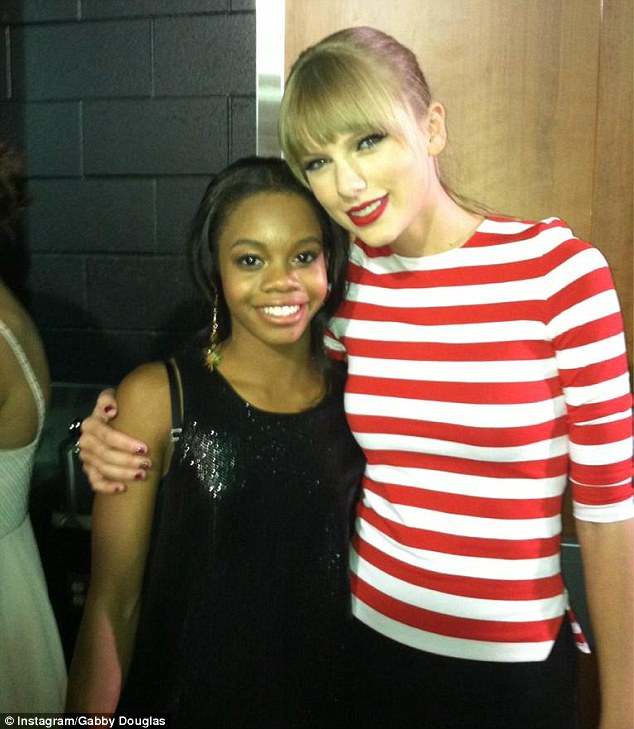 All American girls: Taylor Swift gave Gabby a warm embrace as they hung out backstage