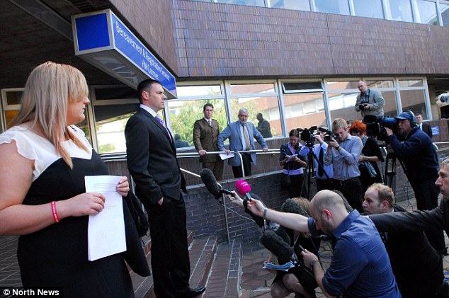 Criticism: Roney's widow Lorna (left) watches as his surviving brother Staff Sgt William Roney address the waiting media outside the coroner's court
