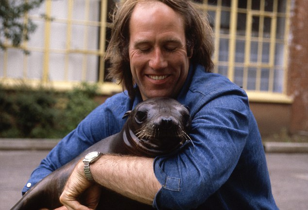 Animal lover: Terry had an affinity with wildlife that children loved - pictured here with a baby seal