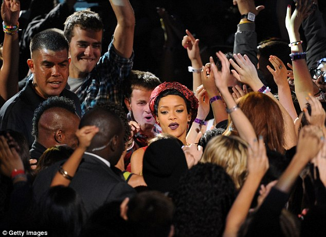 With her Navy: The singer jumped into the crowd as she closed her show to have a little dance with fans
