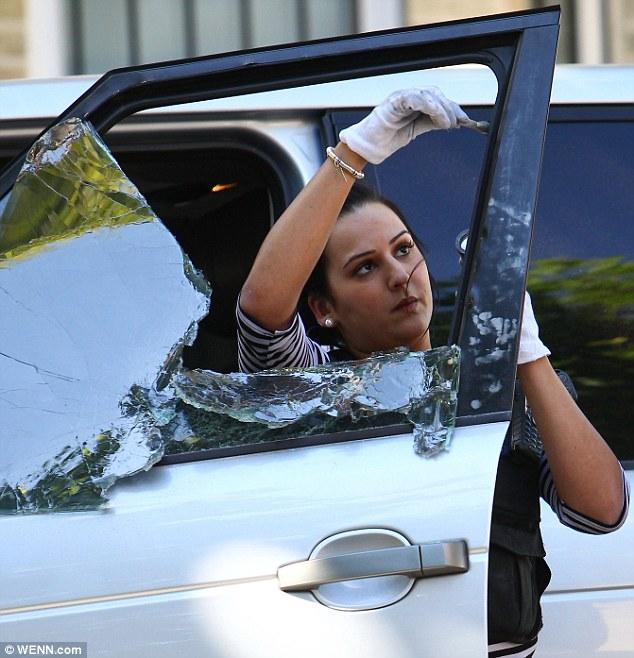CSI London: A Scene of Crime Officer checks the Girls Aloud singer's car for finger prints