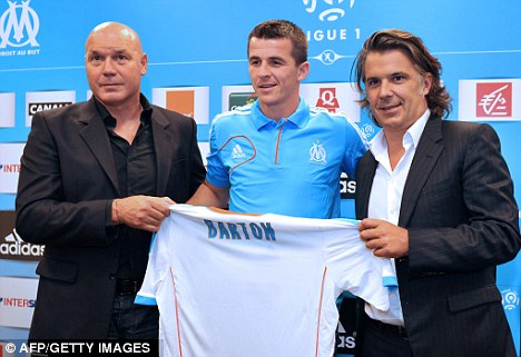 Race: Joey Barton (centre) hopes to be fit to face Fenerbache