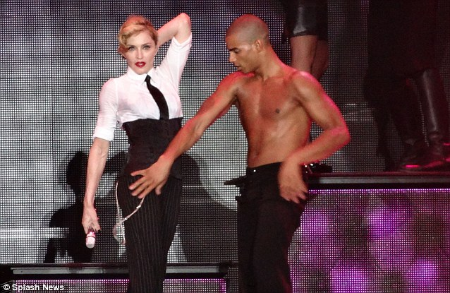 Romance: Madonna was joined on the stage last night by her bare-chested younger boyfriend Brahim Zaibat