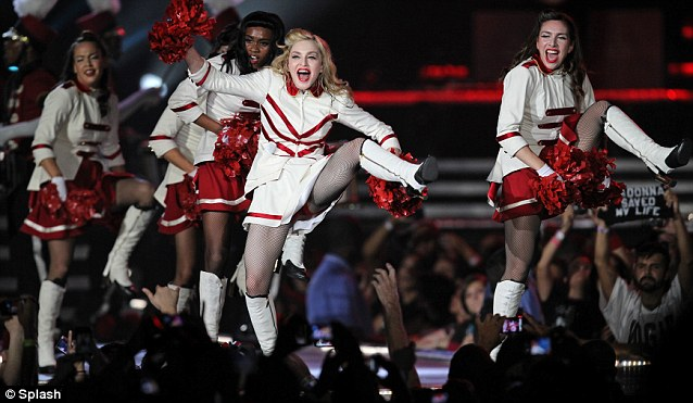 High-kicking: Madonna shows off her agility with some impressive moves onstage