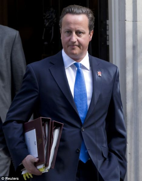 Prime Minister David Cameron leaves Downing Street in London after the reshuffle