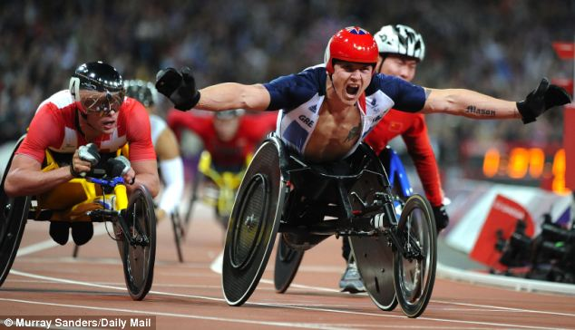 That winning feeling: An ecstatic Weir takes his third gold medal in the stadium on Thursday evening