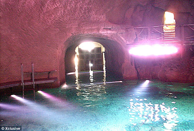Tasteful: Berlusconi chose to decorate his cave with lurid purple walls and bright lights