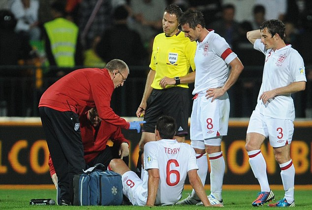 Agony: Terry will miss the European qualifier against Moldova with an ankle injury