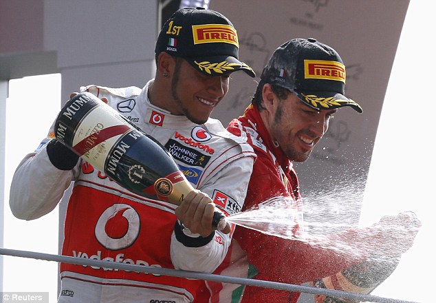 Champagne moment: Hamilton and Alonso enjoy their moment on the podium
