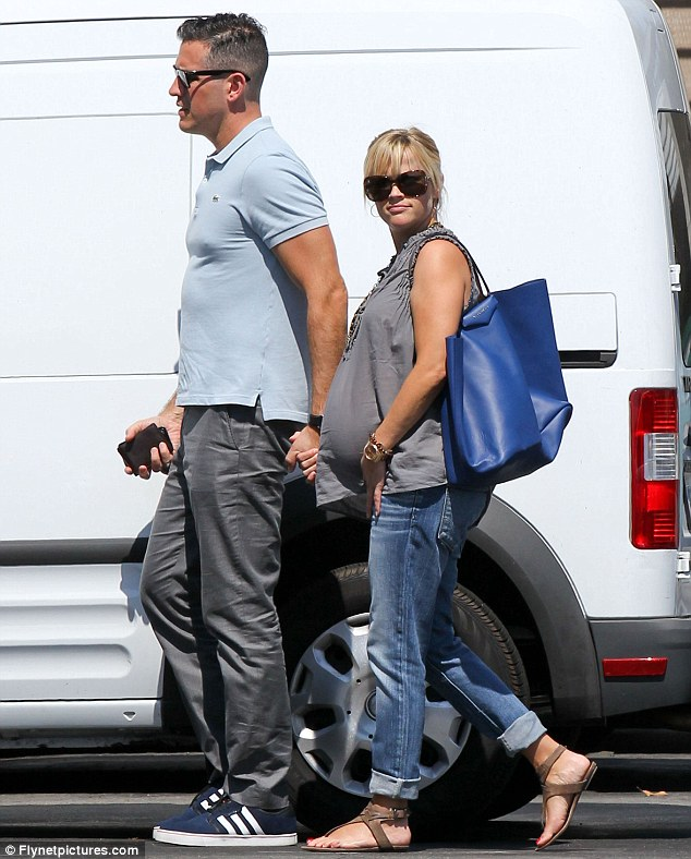 Expectant parents: Reese is expecting her third child - her first with husband Jim Toth