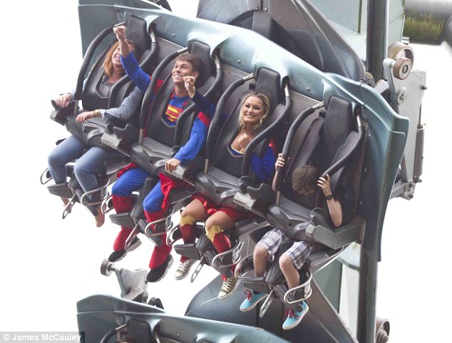 What a couple of plonkers! The pair were seen with their arms raised in the arm as they flew around on the ride