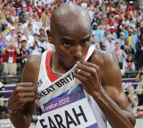 Britain's Mo Farah kisses his jersey