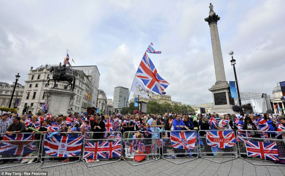 Spectators cram into Trafalgar Square, where they will see the parade go past from about 2.30pm