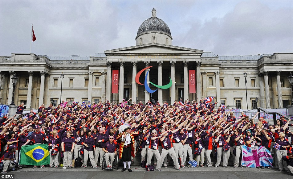 Olympic volunteers pose in front of the National Gallery