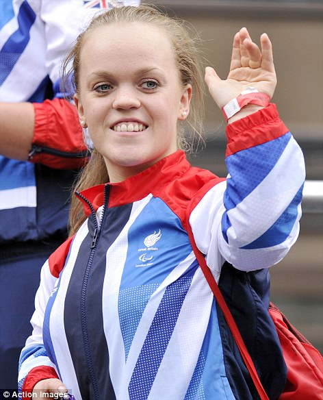 Teenage torpedo: Paralympic swimming  sensation Ellie Simmonds, 17, gives a wave