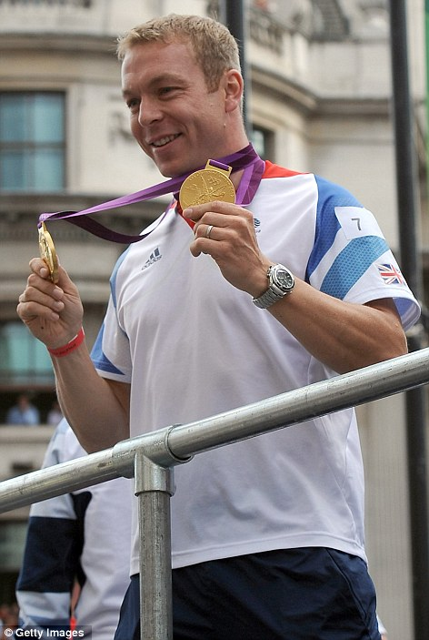 A Knight to remember: Track cycling champion Sir Chris Hoy shows off his two gold medals