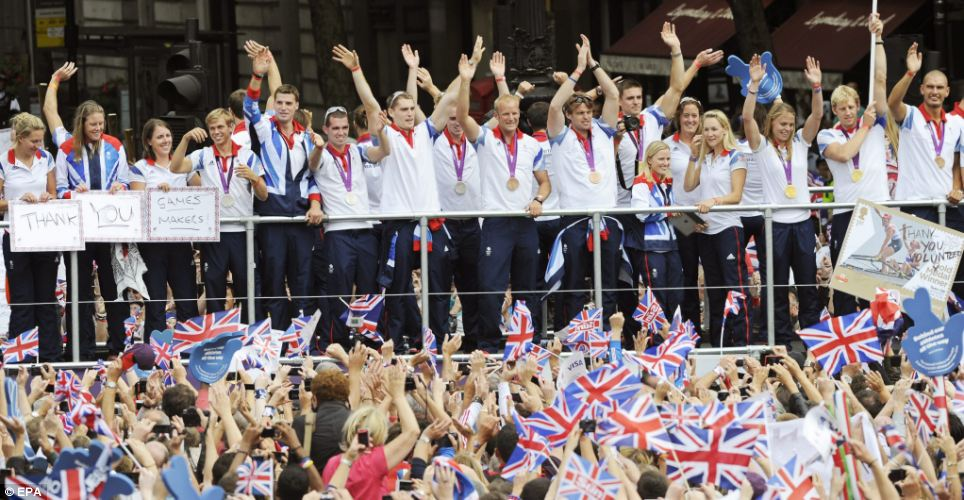 'Our Greatest Team' parade passes by Trafalgar Square in central London as thousands of fans wave flags in celebration
