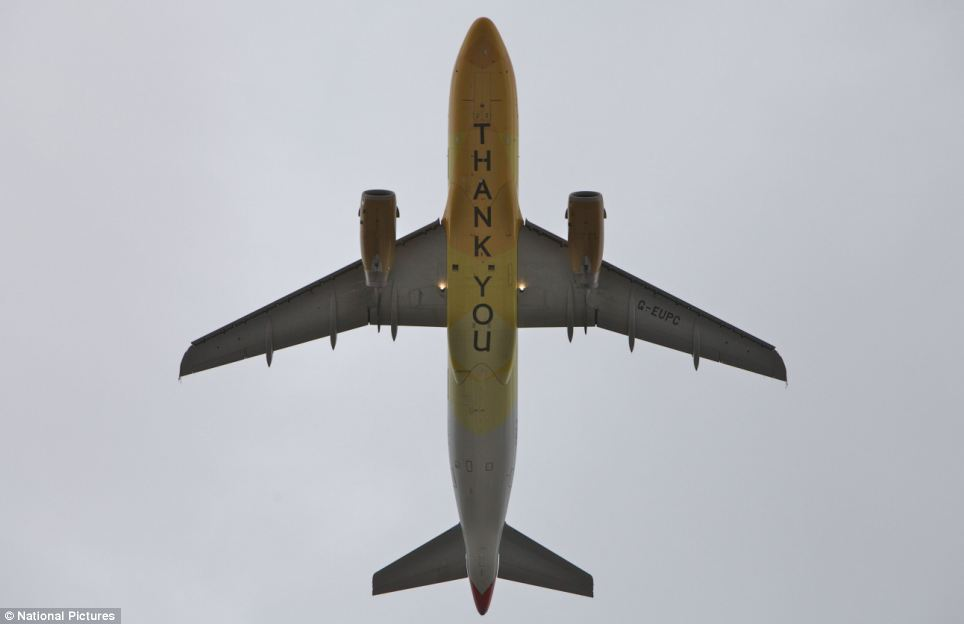 The fly-past completes the parade with a huge 'Thank you' on the underbelly of the plane