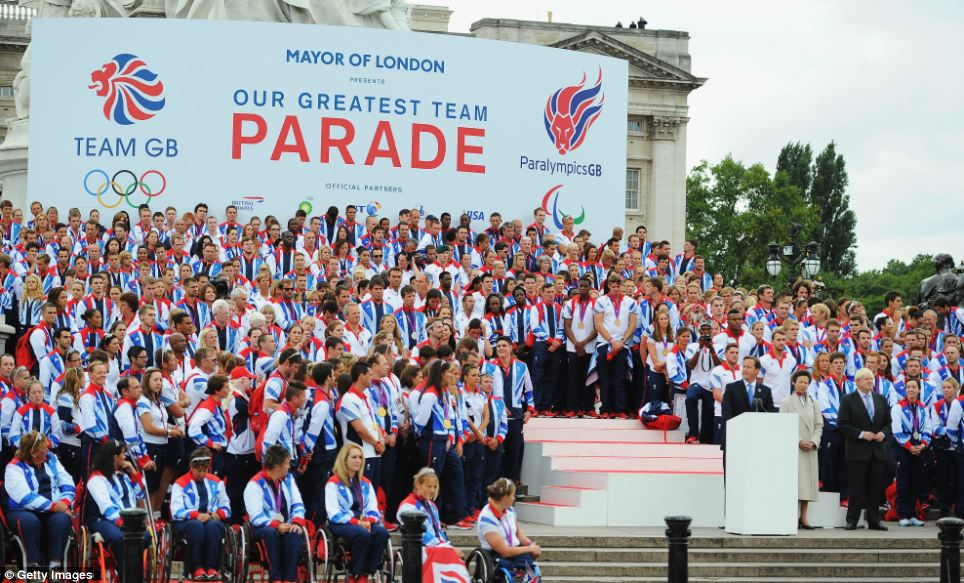 Britain's finest: Team GB and Paralympics GB line up at the end of the victory parade at Buckingham Palace with Prime Minister David Cameron, the Princess Royal and Mayor of London Boris Johnson at the front
