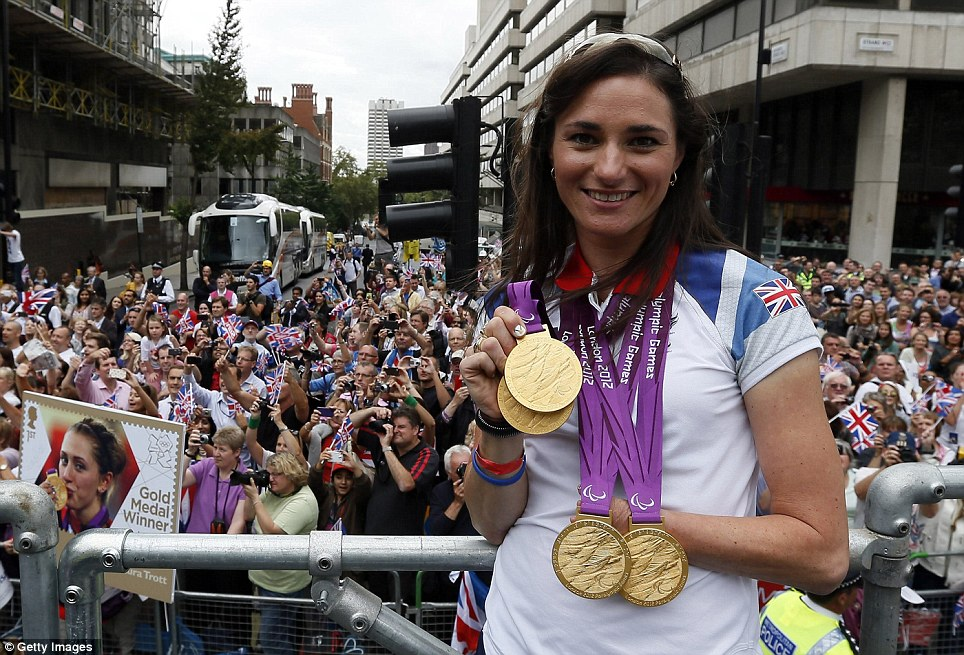 Happy ending: Paralympic cyclist Sarah Storey with her four golds. She was on the float with her husband Barney, also a gold medallist