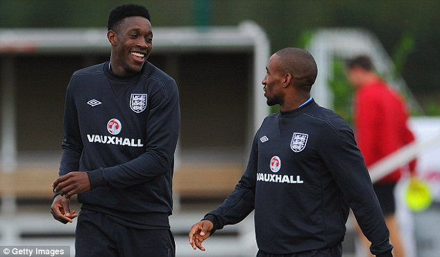 All smiles: Danny Welbeck (left) and Jermain Defoe share a joke