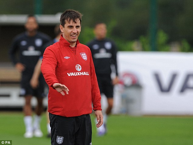 Watchful eye: Gary Neville will be hoping the young English side can overcome the challenge of Ukraine