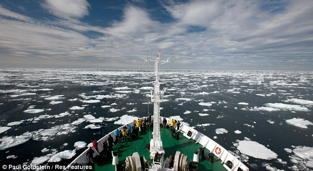 Front row seat: The lucky tourists were travelling aboard a Russian sightseeing icebreaker off the coast of Norway