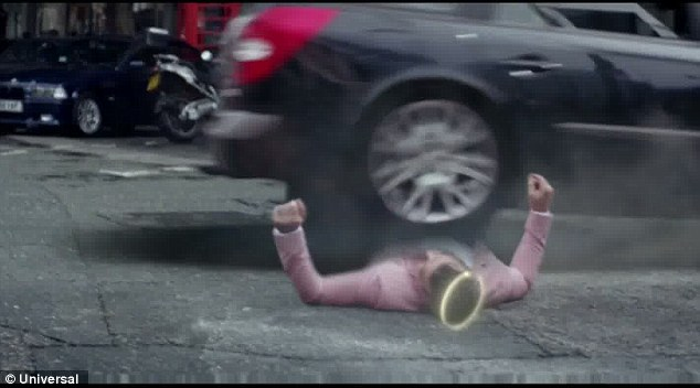 Ouch: Robbie, seen here wearing a halo, throws himself in front of cars to keep Kaya safe