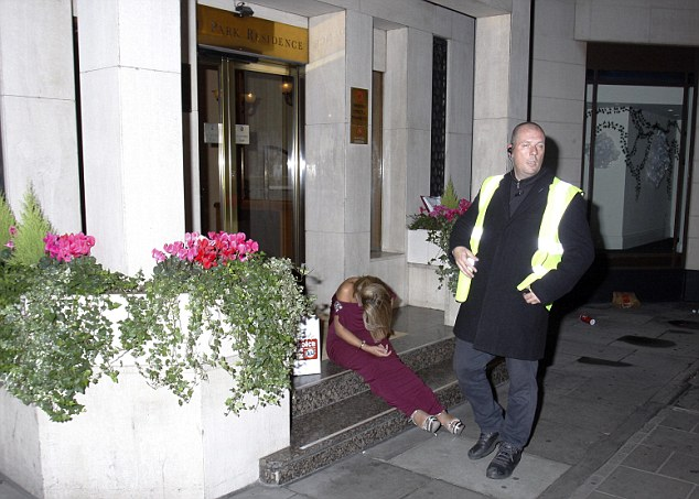 Night over: Tricia Penrose was guarded by a man in a hi-vis jacket after she fell over