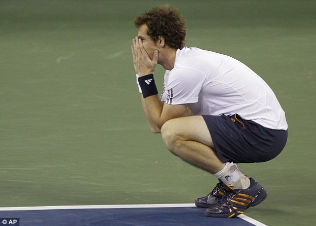 Taking it in: Murray is the first British man to win a Grand Slam title since Fred Perry 76 years ago