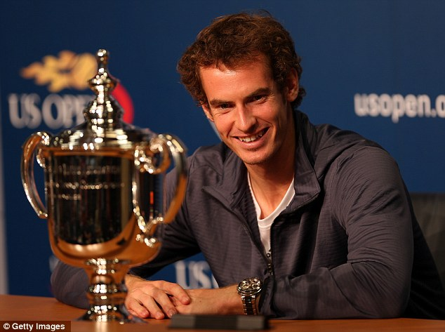 Eyes on the prize: Andy Murray can't divert his gaze from the US Open trophy after his stunning victory