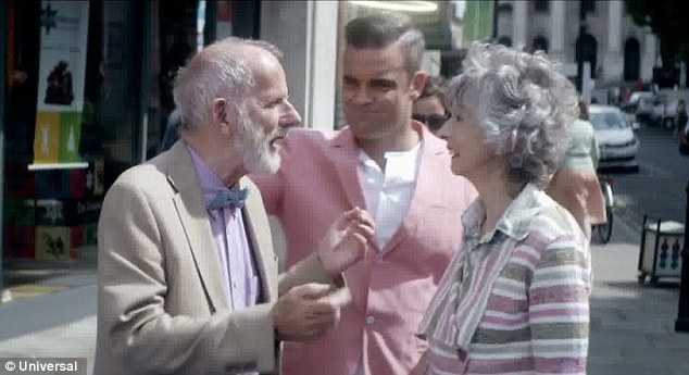 Out the way!: Robbie shoves some old people out of his and Kaya's way