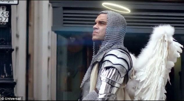 Loving angels instead: Robbie looks divine in a pair of enormous white wings