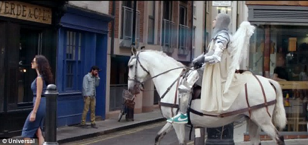Alright on the knight: Robbie returns in the form of a hero on a white steed
